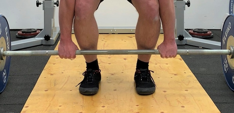 Deadlift with double overhand grip.